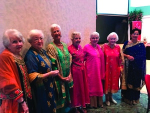 Seniors dressed in Indian sarees and tunics at the John Knox Village of Central Florida senior living community