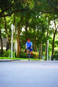 89 year old senior Howard Chana biking through the John Knox Village of Central Florida senior living community
