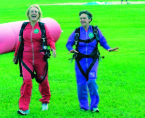 Senior women celebrate after a successful skydive