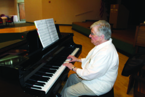 A senior woman playing the piano