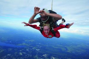 A senior woman tandem skydiving