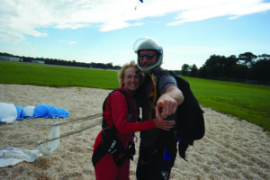 Senior woman celebrating a successful skydive
