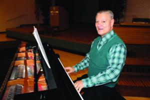 A senior man playing the piano