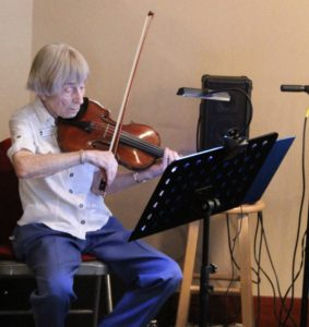 A photo of Rosemary Malocsay playing the violin