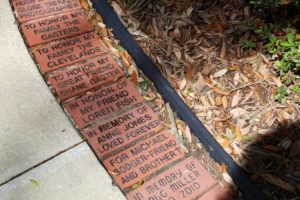 People made donations to the John Knox Foundation, and were then able to place In Memory of messages on bricks used to build the courtyard pathways