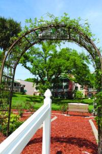 Photo of a dedicated park bench and rose garden at John Knox Village