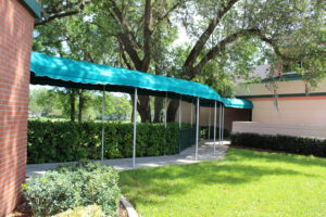 A photo of a covered walkway between buildings at the John Knox Village of Central Florida retirement community