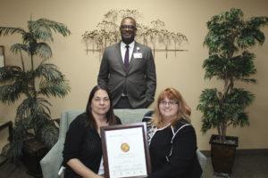 A photo of the Nursing Care Center accreditation award