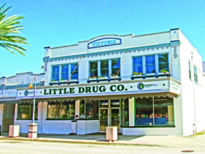 A photo of a classic storefront, named Little Drug Co, in New Smyrna Beach, Florida