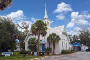 A blue and white church in Orange City, FL