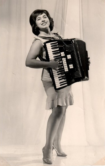Phyllis Dale Playing Accordion with Rosettes