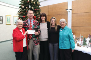 Residents make a donation to the Orange City Elementary School