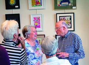 A group of seniors at an art gallery hosted by the John Knox Village of Central Florida