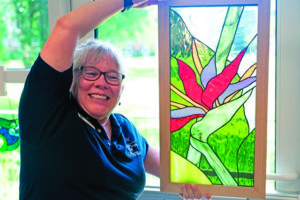 A John Knox resident shows her artistic skills at the recent Resident Gallery