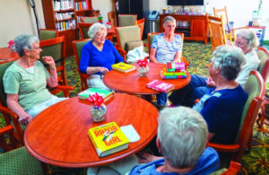 A photo of the John Knox Village book club meeting in the senior living community library