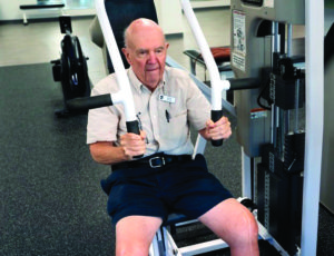A senior man working out in our fitness center