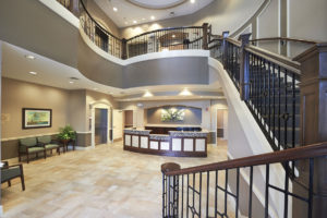 A photo of the main entrance and stairway leading to the John Knox Village senior living community