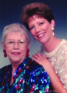 An 90s glamour portrait photo of a senior woman and a woman