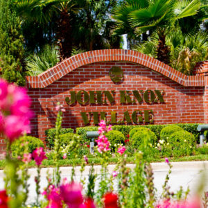A photo of the John Knox Village sign at the building entrance