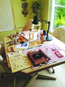 A disassembled clock on a dining room table