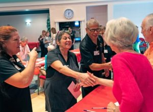 Employees shaking hands with the residents at the John Knox Village of Central Florida senior living residents