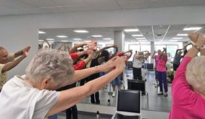 Seniors taking a chair fitness class at the John Knox Village of Central Florida