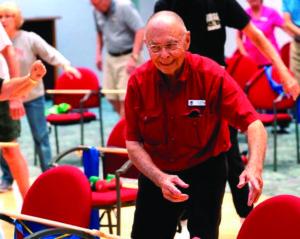 A senior man practices balance exercises at the John Knox Village of Central Florida