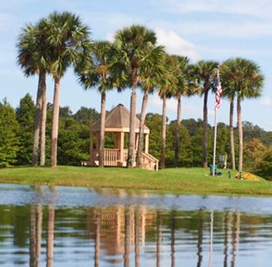 An aerial view of the pond and nature walking paths at the John Knox Village of Central Florida senior living community