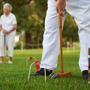 Two seniors playing croquet at the John Knox Village of Central Florida senior living community