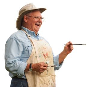 A photo of a senior man painting
