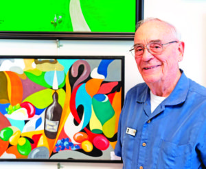 A John Knox resident shows his artistic skills at the recent Resident Gallery