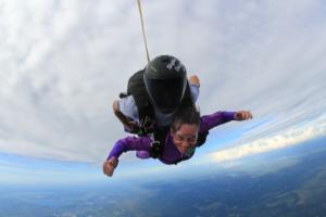 Senior woman skydiving