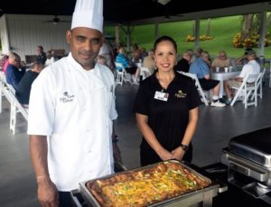 A photo of the chef who prepared the potluck meal for the outdoor event for seniors at John Knox Village