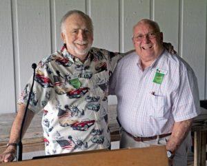 Two senior men pose for a photo