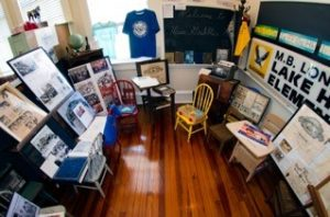 A photo of a room with many framed Lake Helen area newspaper articles and photos