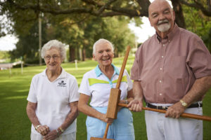 Seniors posing with their croquet mallets at the John Knox Village of Central Florida