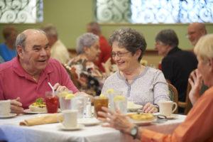 Seniors having conversations during breakfast at the John Knox Village of Central Florida