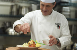 A chef preparing a luxurious meal at the John Knox Village of Central Florida retirement community