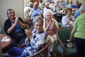 Seniors applauding at an award ceremony