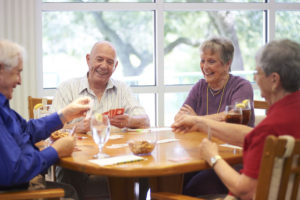 A group of seniors playing poker