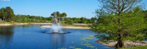 A photo of the fountain in the pond at the John Knox Village of Central Florida retirement community