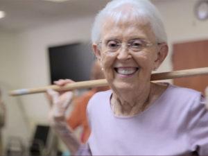 A photo of a senior woman practicing balancing exercises