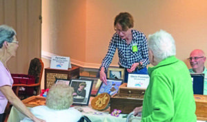 A senior resident showcases her woodworking skills