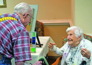 A senior man talks with a senior woman