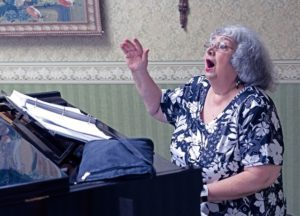 Resident Phyllis Dale plays the piano and sings aloud at the John Knox Village of Central Florida senior living community