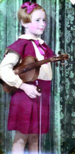 A photo of Rosemary Malocsay holding a violin when she was a young girl