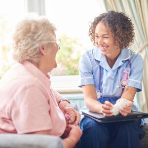 A clinician or physician is talking through a medication prescription with a senior woman