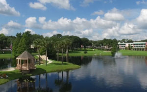 A photo of the large pond, gazebo, and lush walking paths around the nature area at the John Knox Village of Central Florida senior living community in Orange City, FL