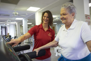 A senior woman working out on a treadmill