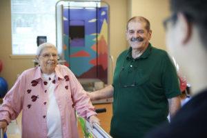 A senior woman at a rehabilitation center working to regain her balance